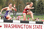 Caroline Austin, Washington State freshman, passes the competition on her way to victory in the 3000 meter steeplechase during the Cougars dual track and field meet with arch-rival Washington at Mooberry Track at Washington State University in Pullman, Washington, on May 1, 2010.