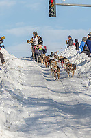 Jeremy Keller on Cordova St. hill during the Anchorage start day of Iditarod 2018 on Cordova St. hill during the Anchorage start day of Iditarod 2019