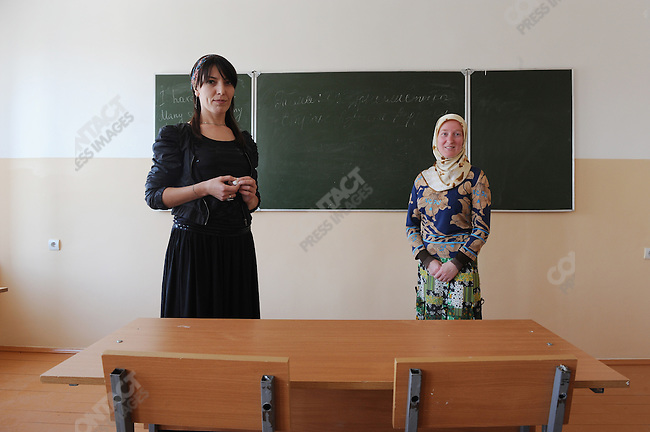 Tamila Chabayeva, 36, (l) and Taisa Magomadova, 35, (r), professors in the journalism faculty of the Chechen State University in Grozny. Chechnya, September 8, 2011