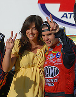 Apr 29, 2007; Talladega, AL, USA; Nascar Nextel Cup Series driver Jeff Gordon (24) celebrates with his pregnant wife Ingrid Vandebosch after winning the Aarons 499 at Talladega Superspeedway. Mandatory Credit: Mark J. Rebilas-