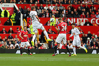 Pictured L-R: Gylfi Sigurdsson of Swansea wins a header against Darren Fletcher of Manchester United. Saturday 16 August 2014<br /> Re: Premier League Manchester United v Swansea City FC at the Old Trafford, Manchester, UK.