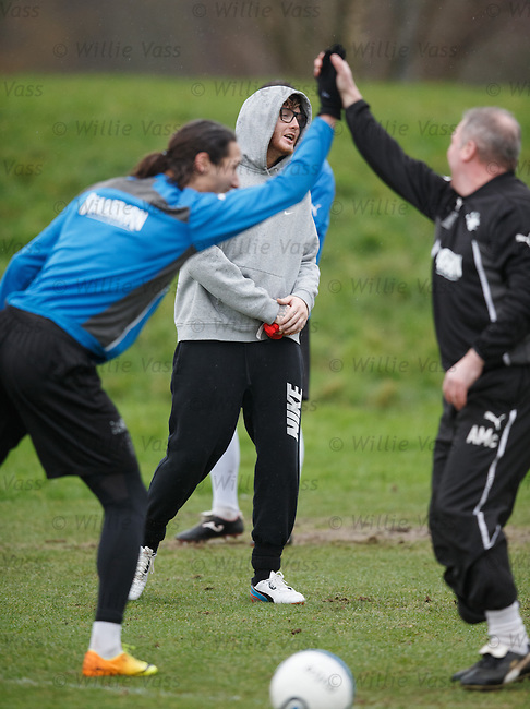 James Arthur is put out of play by Ally McCoist and Bilel Mohsni as the X Factor winner trains with Rangers ahead of tonight's gig at the Hydro in Glasgow