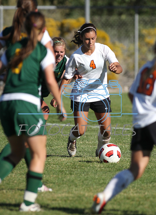 Douglas' Lexi VonSchottenstein plays in Tuesday's 4-1 victory over Manogue, Sept. 20, 2011 at Douglas High School in Gardnerville, Nev..Photo by Cathleen Allison