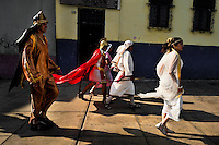 Peruvian actors, performing as Roman soldiers and citizens of Bethlehem, walk in the Good Friday procession during the Holy week in Lima, Peru, 30 March 2013. The annual Passion Of Christ procession, held as part of Easter celebrations, starts in Lima downtown and, followed by thousands of catholic believers, it climbs to the top of the dry and rocky hill of San Cristobal, where Mario Valencia, who has been playing the role of Jesus Christ for more than 30 years, is symbolically crucified.