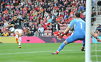 Burnley's Jack Cork curls the ball past Southampton's Alex McCarthy before seeing his effort disallowed<br /> <br /> Photographer Kevin Barnes/CameraSport<br /> <br /> The Premier League - Southampton v Burnley - Sunday August 12th 2018 - St Mary's Stadium - Southampton<br /> <br /> World Copyright &copy; 2018 CameraSport. All rights reserved. 43 Linden Ave. Countesthorpe. Leicester. England. LE8 5PG - Tel: +44 (0) 116 277 4147 - admin@camerasport.com - www.camerasport.com