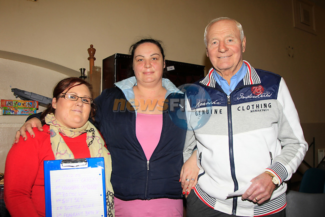 Allana Andrews with Anita &amp; Jim Lynch during an Auction for the Duleek Senior Citizens in the Duleek Community Centre on Saturday 15th November 2014.<br /> Picture:  Thos Caffrey / www.newsfile.ie