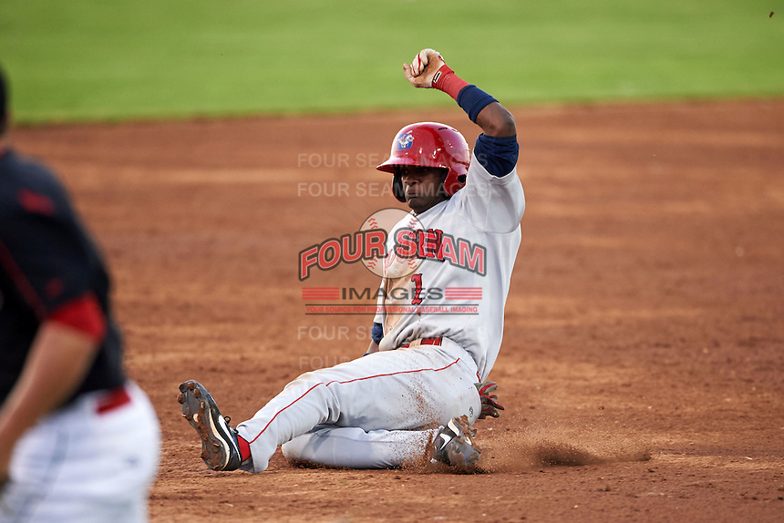 Auburn Doubledays shortstop Edwin Lora (1) slides into third during a game against the Batavia Muckdogs on July 10, 2015 at Dwyer Stadium in Batavia, New York.  Auburn defeated Batavia 13-1.  (Mike Janes/Four Seam Images)