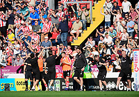 Lincoln City manager Danny Cowley and Lincoln City's assistant manager Nicky Cowley, second in from left, celebrate after winning the league<br /> <br /> Photographer Chris Vaughan/CameraSport<br /> <br /> The EFL Sky Bet League Two - Lincoln City v Tranmere Rovers - Monday 22nd April 2019 - Sincil Bank - Lincoln<br /> <br /> World Copyright © 2019 CameraSport. All rights reserved. 43 Linden Ave. Countesthorpe. Leicester. England. LE8 5PG - Tel: +44 (0) 116 277 4147 - admin@camerasport.com - www.camerasport.com