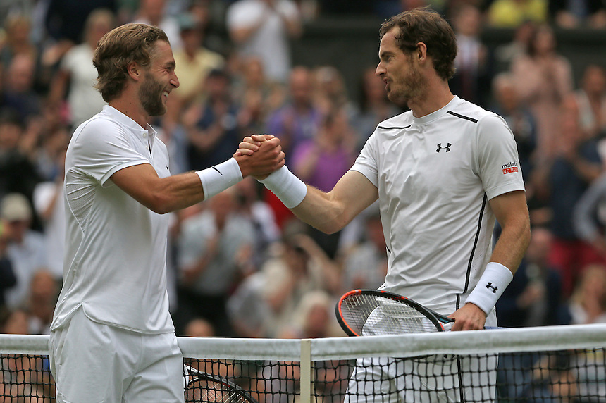 Andy Murray of Great Britain is congratulated by Liam Broady of Great Britain  after his victory in their Gentlemen's Singles First Round match today<br /> <br /> Photographer Stephen White/CameraSport<br /> <br /> Tennis - Wimbledon Lawn Tennis Championships - Day 2 - Tuesday 28th June 2016 -  All England Lawn Tennis and Croquet Club - Wimbledon - London - England<br /> <br /> World Copyright &copy; 2016 CameraSport. All rights reserved. 43 Linden Ave. Countesthorpe. Leicester. England. LE8 5PG - Tel: +44 (0) 116 277 4147 - admin@camerasport.com - www.camerasport.com