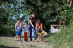 Deaconess Maria Jessica Cicillo points out an object of interest as she walks with a group of children in Mt. Heights, Philippines, where she works as a Christian educator for a nearby United Methodist Church. She is a graduate of Harris Memorial College.