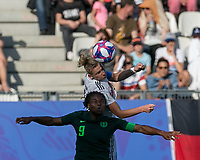GRENOBLE, FRANCE - JUNE 22: Desire Oparanozie #9, Alexandra Popp #11 battle for head ball during a game between Nigeria and Germany at Stade des Alpes on June 22, 2019 in Grenoble, France.