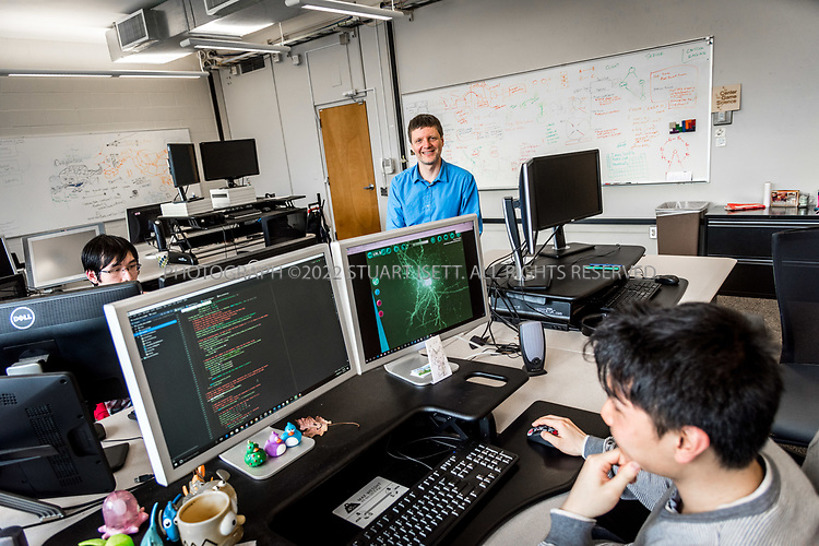 4/19/2017&mdash; Seattle, WA, USA<br /> <br /> University of Washington professor, Zoran Popovic&rsquo;s lab where students and developers are helping him build the videogame Mozak. <br /> <br /> Here:  University of Washington graduate student Zuoming Shi, 24, (back) and developer Roy Szeto, 27, (foreground) work on the Mozak project.<br /> <br /> The game has been created by a team at the University of Washington in Seattle led by professor Popovic and uses the skills of novice players to model brain cells with a much higher degree of accuracy than conventional computer-based modeling tools. Mozak is first collaborating with the Allen Institute for Brain Science in Seattle on the effort, but there will eventually be other participants from academia that use Mozak. <br /> <br /> Photograph by Stuart Isett. &copy;2017 Stuart Isett. All rights reserved.