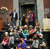 Washington, DC - December 11, 2009 -- Rabbi Gil Steinlauf of Washington's Adas Israel Congregation lights a Hanukkah Menorah to mark the first night of the Jewish Holiday, Friday, December 11, 2009 as children from the Gan Ha-Yeled pre-school look on..Credit: Ron Sachs / CNP