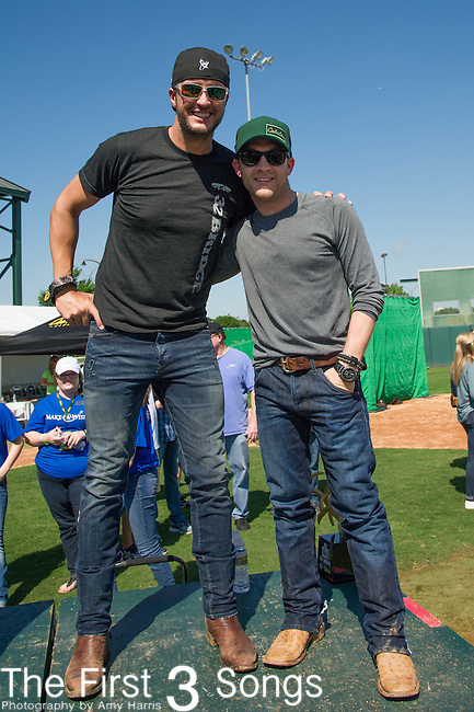 Justin Moore and Luke Bryan attend the ACM & Cabela's Great Outdoor Archery Event during the 50th Academy Of Country Music Awards at the Texas Rangers Youth Ballpark on April 18, 2015 in Arlington, Texas.
