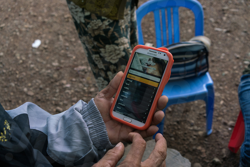 November 28, 2016 - Pailin (Cambodia). Norng Chhay reads the bible with a smartphone's app that one of his children downloaded for him. Nornh was a Khmer Rouge soldier for almost 20 years and he converted to Christianity in 2000. © Thomas Cristofoletti / Ruom