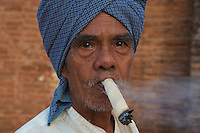 Man with a huge local cigar Bagan Town and market, Myanmar