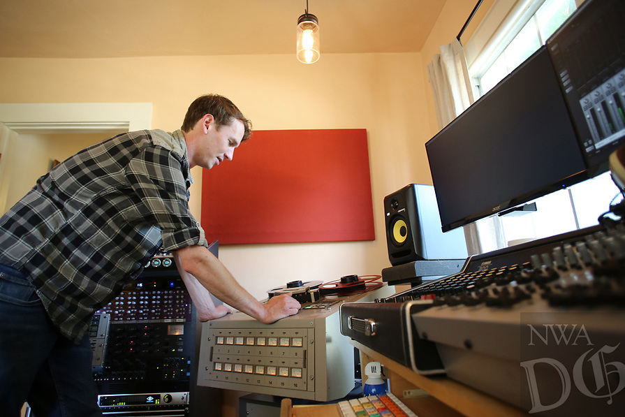 NWA Democrat-Gazette/DAVID GOTTSCHALK Eric Witthans works with the tape deck and sound board  Monday, July 16, 2018, at the state-of-the-art Homestead Recording audio recording studio in Fayetteville.