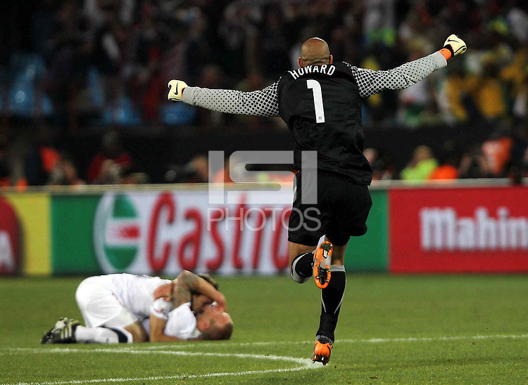 Tim Howard of USA celebrates after winning against Algeria
