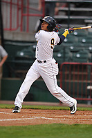 Burlington Bees designated hitter Gleyvin Pineda (9) swings at pitch against the Dayton Dragons at Community Field on May 2, 2018 in Burlington, Iowa.  (Dennis Hubbard/Four Seam Images)