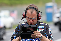 May 10, 2013; Commerce, GA, USA: NHRA crew chief Jim Prock for funny car driver Robert Hight (not pictured) during qualifying for the Southern Nationals at Atlanta Dragway. Mandatory Credit: Mark J. Rebilas-