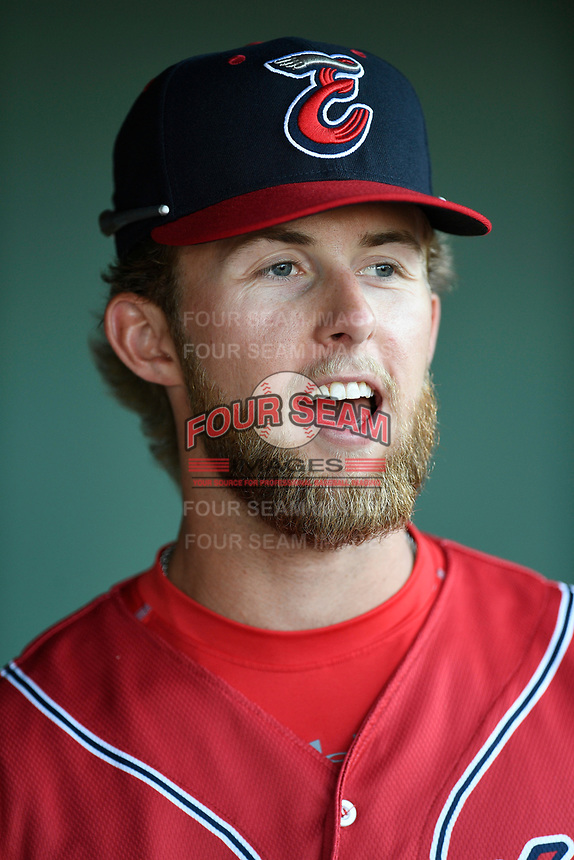 Center fielder Cole Brannen (10) of the Greenville Drive, playing as the Energia in MiLB's Copa de la Diversion, in the dugout before a game against the Augusta GreenJackets at Fluor Field at the West End in Greenville, South Carolina. Augusta won, 9-8. (Tom Priddy/Four Seam Images)