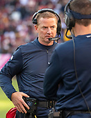 Dallas Cowboys head coach Jason Garrett speaks with an assistant coach during a break in the second quarter action against the Washington Redskins at FedEx Field in Landover, Maryland on Sunday, October 21, 2018.<br /> Credit: Ron Sachs / CNP