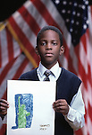 African American student with drawing of statue of liberty