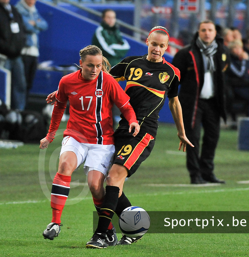 20130925 - OSLO , NORWAY : Duel  pictured between Belgian Lore Vanschoenwinkel (19) and Norwegian Kristine Hegland (17)  during the female soccer match between Norway and Belgium , on the second matchday in group 5 of the UEFA qualifying round to the FIFA Women World Cup in Canada 2015 at the Ullevaal Stadion , Oslo . Wednesday 25th September 2013. PHOTO DAVID CATRY