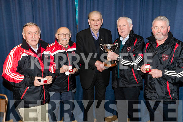 Rathmore quiz team - winners l-r: Donal O'Leary, John O'Sullivan, Jackie Welsh, Vice Chairman presenting the cup to team captain Dan V O'Connor, Tony Moynihan at the Scor Sinsear county finals at Mhuire Gan Smal, Castleisland on Saturday night.