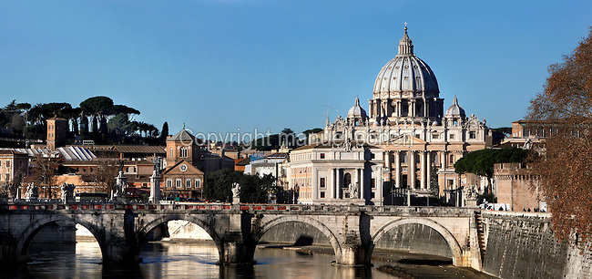 Panoramic view of Ponte Sant'Angelo with, on the right St Peter's Cathedral, Vatican City, Rome, Italy, pictured on December 13, 2010 in the morning. The Vatican City, centre of the Roman Catholic Church, is an independent state, founded in 1929. St Peter's Basilica was rebuilt during the Renaissance period. Its first architect was Donato Bramante (1444-1514), and the dome was designed by Michelangelo (1475-1564) and completed by Giacomo della Porta (c.1533-1602). The Piazza di San Pietro with its magnificent Baroque colonnades was designed by Gian Lorenzo Bernini (1598-1680). Picture by Manuel Cohen
