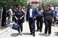 "Pictured: Local mayor Yiannis Kassavos (C) arrives at the 6th primary School in Acharnes, Athens, Greece. Saturday 10 June 2017<br /> Re: An 11 year old boy has been shot dead by a ""stray bullet"" during a school celebration in Acharnes (Menidi) area, in the outskirts of Athens, Greece.<br /> Marios Dimitrios Souloukos ""complained to his mum"" who works as a teacher at the 6th Primary School of Acharnes that he was feeling unwell, he then collapsed with blood pouring out from the top of his head.<br /> His mum tried to revive him assisted by other teachers while his schoolmates who were reportedly upset, were hurriedly removed by their parents.<br /> According to locals an ambulance arrived 25 minutes late.<br /> Hundreds of police officers have been deployed in the area and have raided many properties.<br /> Shells matching the fatal bullet which hit the boy on the top of his head were found in a house yard nearby.<br /> Local people reported hearing shots being fired at a nearby Romany Gypsy camp before the fatal incident.<br /> The area has been plagued with criminality during the last few years."