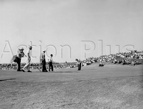 27.06.1960. Canada. Sam Snead of the USA sinks the final putt watched by Kel Nagle, Arnold Palmer and Peter Thompson. Snead and Palmer won the Canada Cup Gold Tournament 27 June 1960