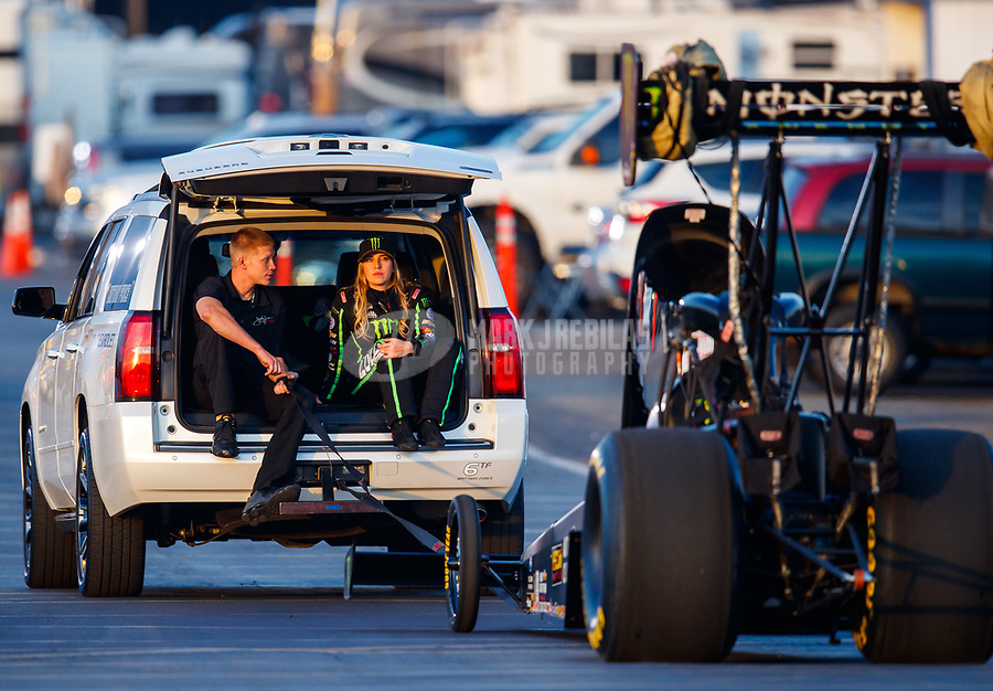 Nov 10, 2017; Pomona, CA, USA; NHRA top fuel driver Brittany Force (right) sits next to a crew member during qualifying for the Auto Club Finals at Auto Club Raceway at Pomona. Mandatory Credit: Mark J. Rebilas-USA TODAY Sports
