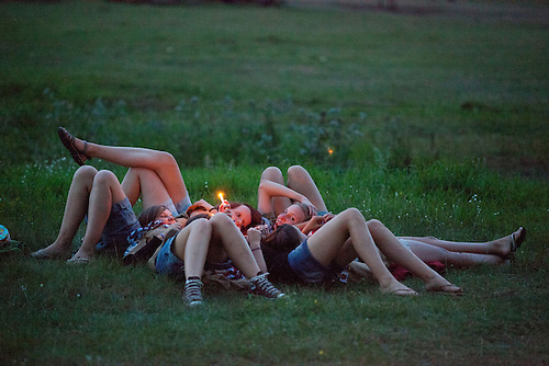 Girls resting and watching a candle burn in winter area.