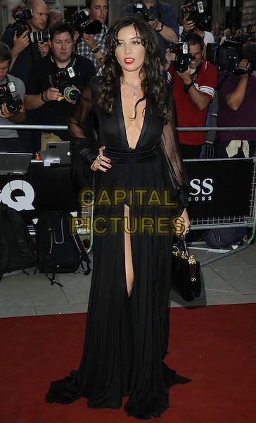 Daisy Lowe<br /> GQ Men of the Year Awards 2013 at the Royal Opera House, London, England.<br /> September 3rd, 2013<br /> full length black sheer dress handbag plunging neckline cleavage slit split hand on hip<br /> CAP/CAN<br /> &copy;Can Nguyen/Capital Pictures