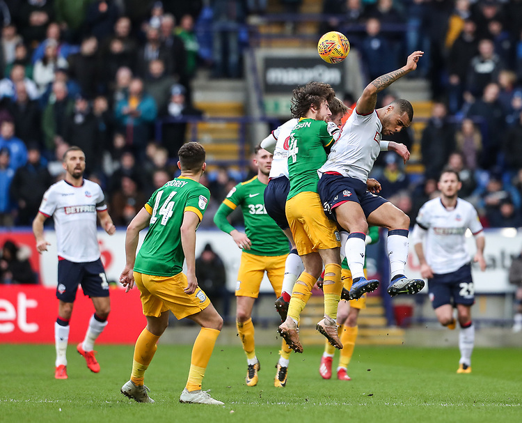 Bolton Wanderers' Josh Magennis competing with Preston North End's Ben Pearson  <br /> <br /> Photographer Andrew Kearns/CameraSport<br /> <br /> The EFL Sky Bet Championship - Bolton Wanderers v Preston North End - Saturday 9th February 2019 - University of Bolton Stadium - Bolton<br /> <br /> World Copyright &copy; 2019 CameraSport. All rights reserved. 43 Linden Ave. Countesthorpe. Leicester. England. LE8 5PG - Tel: +44 (0) 116 277 4147 - admin@camerasport.com - www.camerasport.com