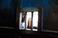 A guard stands outside of the holding cells in Nairobi's Central Police Station.