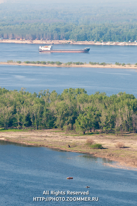 Barge going by Zelenenky island in Volga near Samara