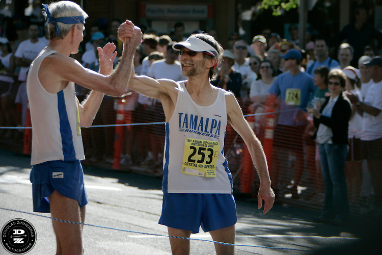 (l-r) Runner (2) Russ Kiernan of Mill Valley, Calif. and Hans Schmidt of Greenbrae, Calif. (253) clasp hands at the starting line for the 98th Dipsea Race in downtown Mill Valley.  The Dipsea starts in Mill Valley and ends in Stinson Beach over Mt. Tamalapais  on Sunday, June 8, 2008.