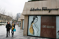 People pass a Salvatore Ferragamo store in Shanghai, China. Salvatore Ferragamo and many other top-end designers are expanding into China despite the proliferation of fakes easily available..13 Mar 2006.