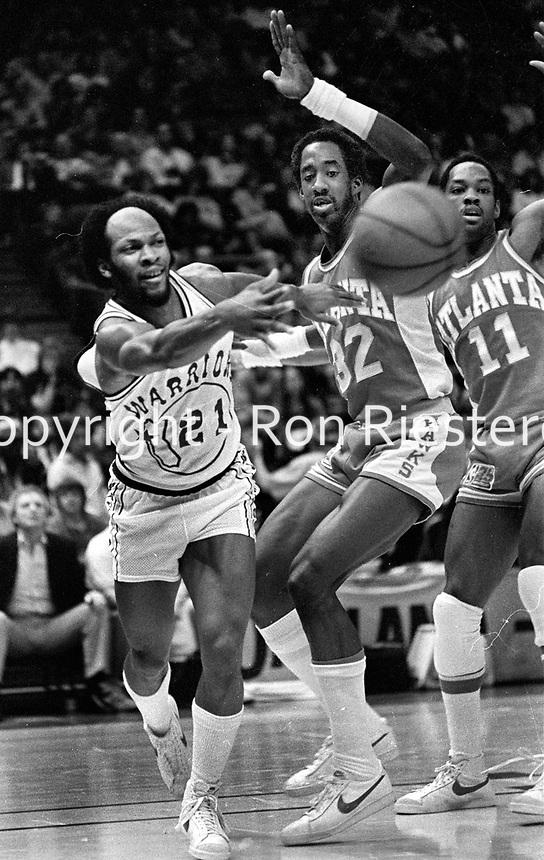 "Warrioirs Loyd ""World"" Free #21 against the Atlanta Hawks.#32 Dan Roundfield, and #11 Craig Shelton.<br /> (1981 photo/Ron Riesterer)"