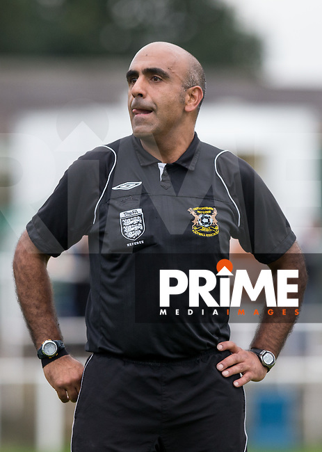 Referee Neo Neophytou (Rickmansworth) during the Molten Spartan South Midlands Premier match between Oxhey Jets and Colney Heath on Non League Day at Altham Way, South Oxhey, England on 10 October 2015. Photo by Andy Rowland.