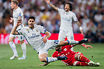 Marco Asensio Willemsen (r) of Real Madrid gets tripped as he fights for the ball with Arturo Vidal of FC Bayern Munich during their 2016-17 UEFA Champions League Quarter-finals second leg match between Real Madrid and FC Bayern Munich at the Estadio Santiago Bernabeu on 18 April 2017 in Madrid, Spain. Photo by Diego Gonzalez Souto / Power Sport Images
