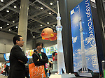 June 16th, 2011, Tokyo, Japan - Visitors admire a 1/1000 scale model of the Tokyo Sky Tree as the International Tokyo Toy Show 2011 opens in Tokyo Thursday, June 16, 2011. More than 130 domestic and foreign toy manufacturers and companies featured about 35,000 toys in the four-day show, the largest of its kind in Japan.  The domestic toy market grew 3.5 percent in the business year ended in March from a year earlier, the first increase in three years, according to the Japan Toy Association. (Photo by Natsuki Sakai/AFLO) [3615] -mis-