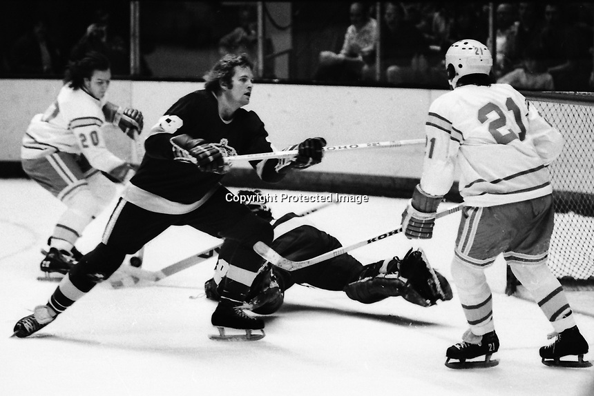 Seals vs Los Angeles Kings 1975. Kings Neil Komadoski blocks Seals Dennis Maruk, #20Bob Murdoch and King goalie Rogie Vachon. (photo/Ron Riesterer)
