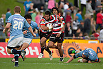 Siale Piutau heads up field after pushing off Dean Budd. ITM Cup rugby game between Counties Manukau Steelers and Northland, played at Bayer Growers Stadium, Pukekohe, on Sunday September 26th 2010..The Counties Manukau Steelers won 40 - 24 after leading 27 - 7 at halftime.