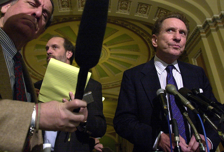 6Specter021301 -- Sen. Arlen Specter talks to reporters after the Senate Luncheons.