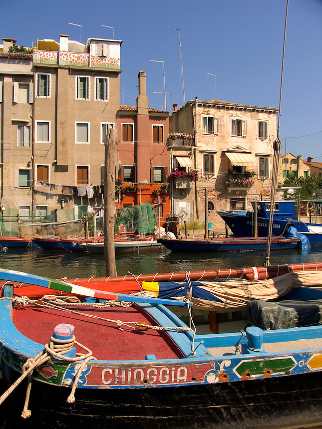 Fishing boats moored along Vena canal in Chioggia Ital