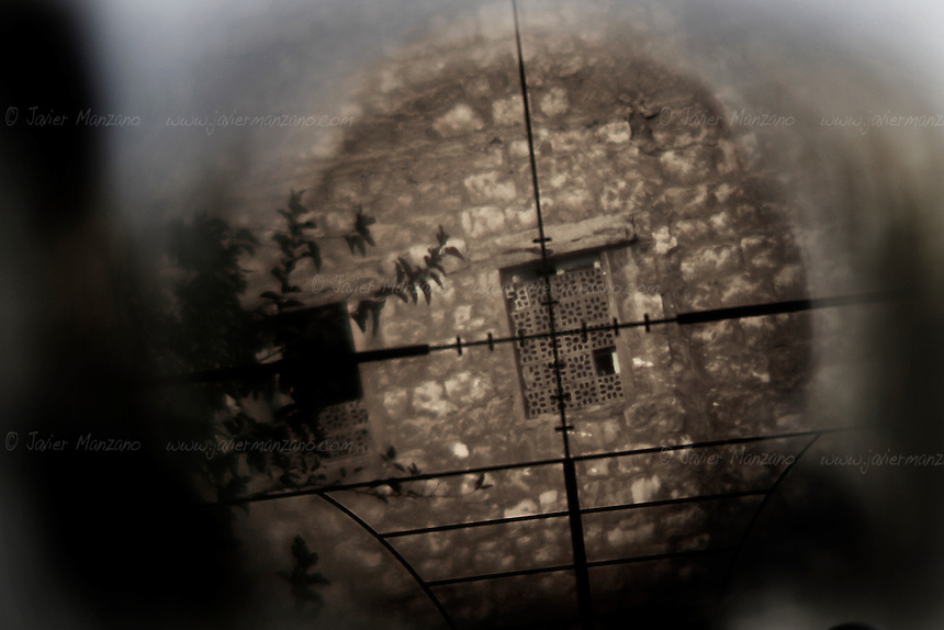 The window from a building near a government-controlled area of Aleppo is seen through the telescope of a Free Syria Army sniper. Aleppo, Syria - October 2012...© Javier Manzano