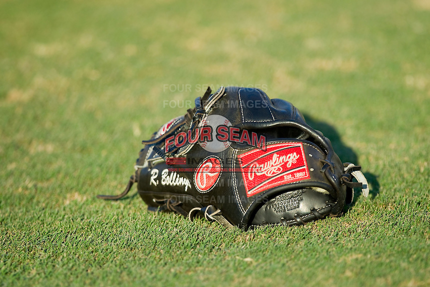 The Rawlings baseball glove of Ryan Bollinger (not pictured) of the Kannapolis Intimidators sits on the field prior to the South Atlantic League game against the Rome Braves at CMC-Northeast Stadium on August 24, 2013 in Kannapolis, North Carolina.  The Intimidators defeated the Braves 6-1.  (Brian Westerholt/Four Seam Images)